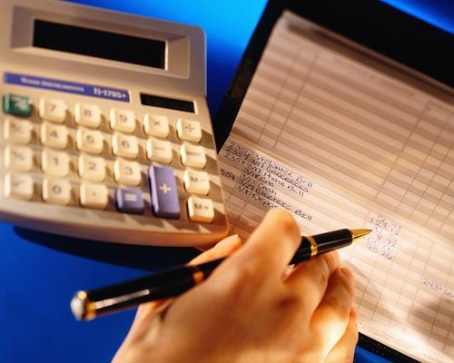 Woman Balancing Her Checkbook