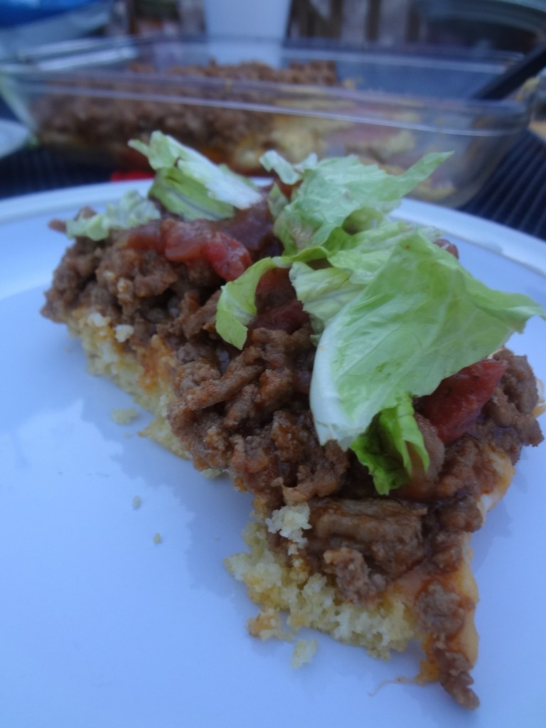 This Taco Cornbread Pizza is a recipe you can throw together in a pinch. Stop by for the super simple recipe!