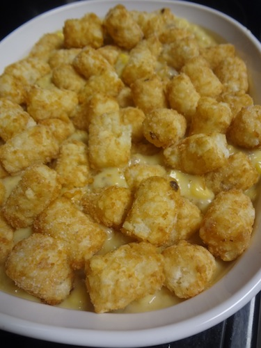 casserole topped with tator tots read for the oven