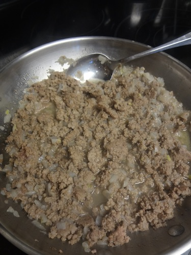 ground turkey cooking in a pan