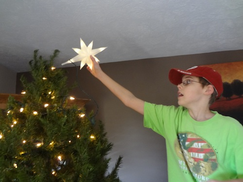 joel putting the star on the tree