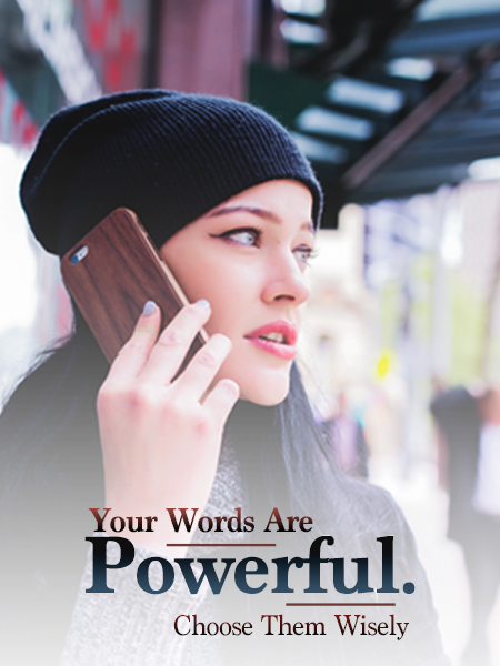 woman with dark hair, wearing beanie and talking on the phone