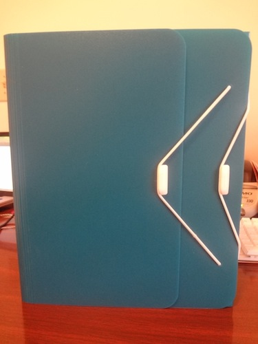 teal duo binder on top of a brown desk