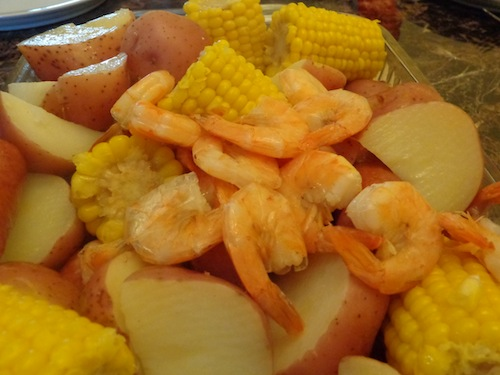 Don't be intimidated by a shrimp boil! This Super Easy Shrimp Boil recipe uses frozen corn and fully cooked shrimp and sausage - definitely an easy dinner!