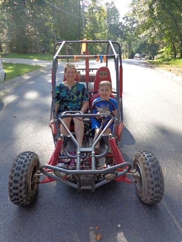 mom and levi on go-kart