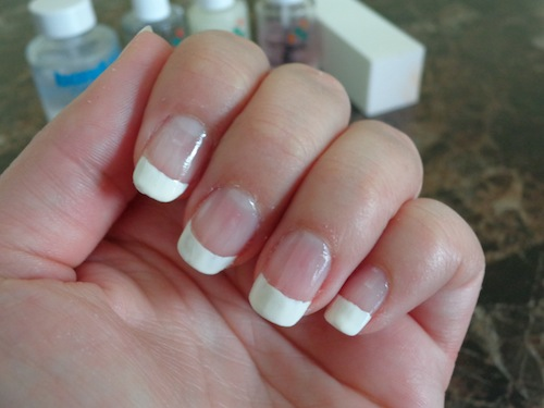 finger nails with freshly polished French manicure