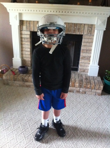 Jayden with football helmet