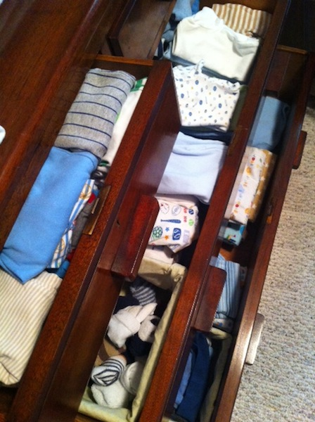 baby clothes in dresser