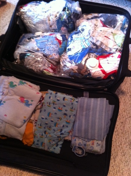 baby clothes in suitcase