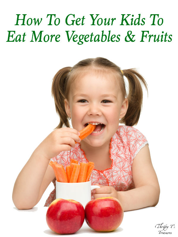 little girl eating carrots and apples