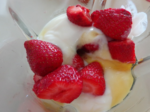 strawberries, yogurt and honey in mixer