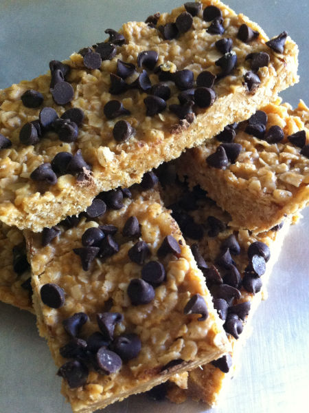 stack of 4 chewy granola bars with chocolate chips on top