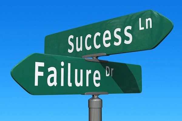 success lane and failure drive street signs