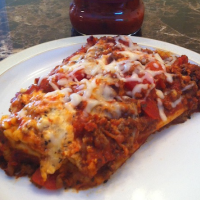 Save time in the kitchen with this super easy crockpot manicotti. Using this no boil recipe you'll have dinner in the slow cooker in no time!