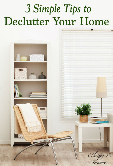 minimalist sitting area with chair and bookshelf