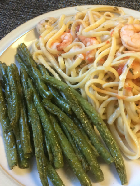 plate of green beans and shrimp pasta
