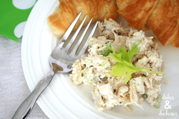 plate of chicken salad with croissant