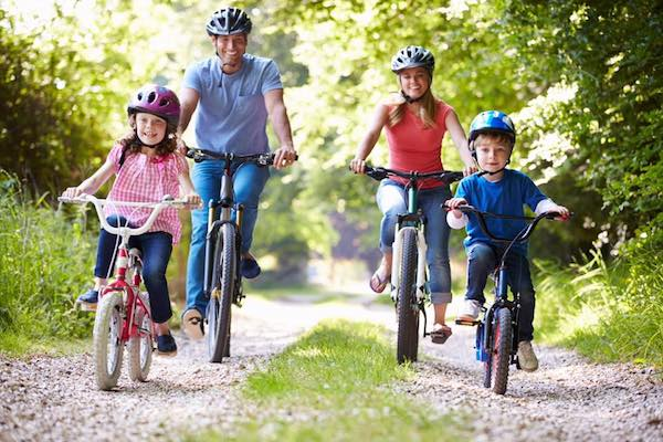 family riding bikes on a gravel road