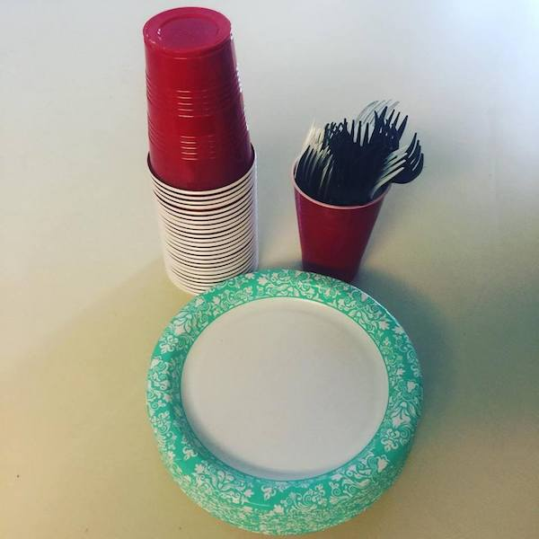 paper plates and plastic cups and forks