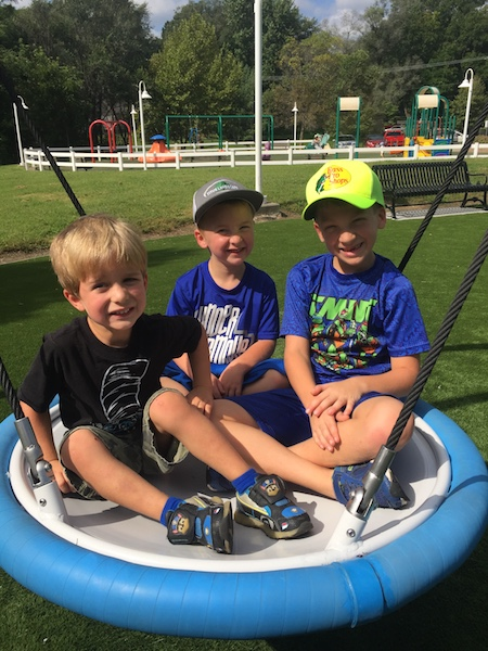 Cole, Kade and Dalton on a round swing