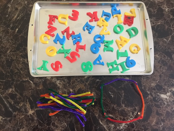 cookie sheet with magnetic letters, and wiki sticks