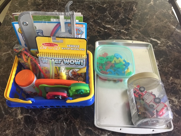 screen free road trip activities organized in a basket