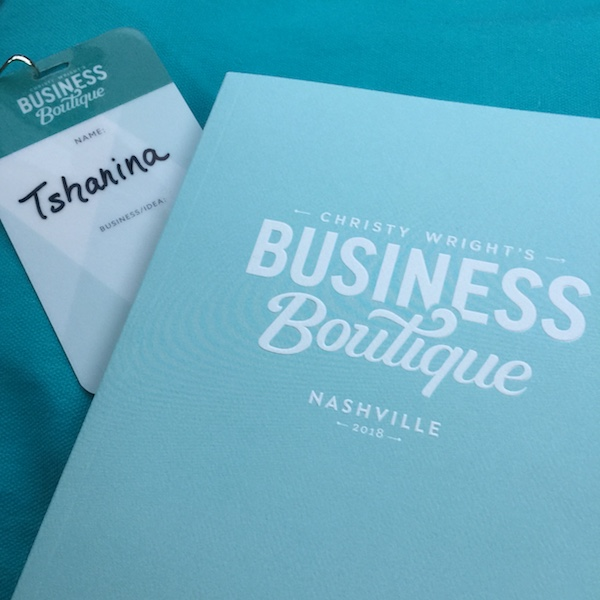book and nametag from business boutique in nashville, tn
