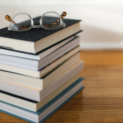 stack of books with glasses o