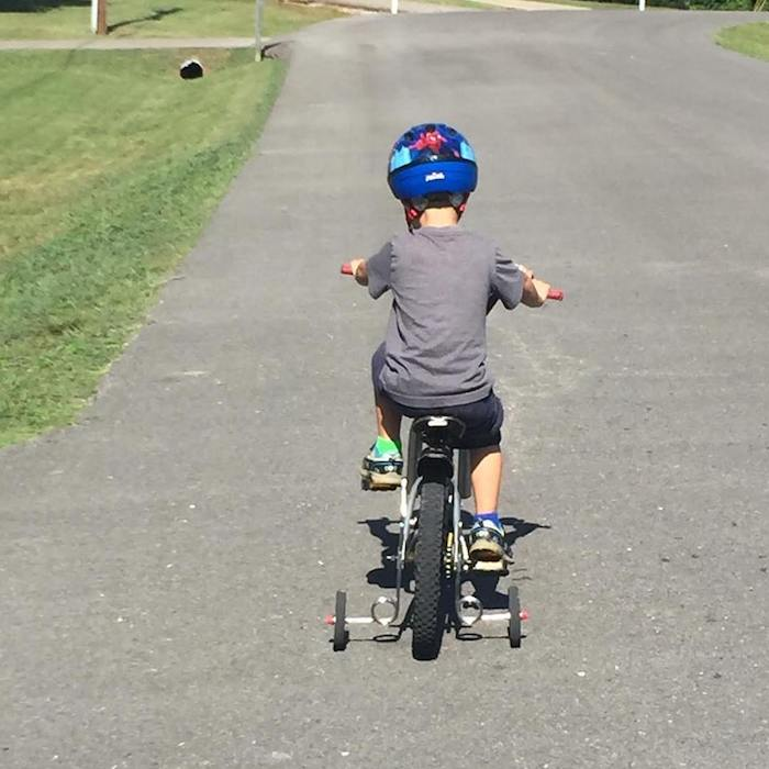 little boy riding bike