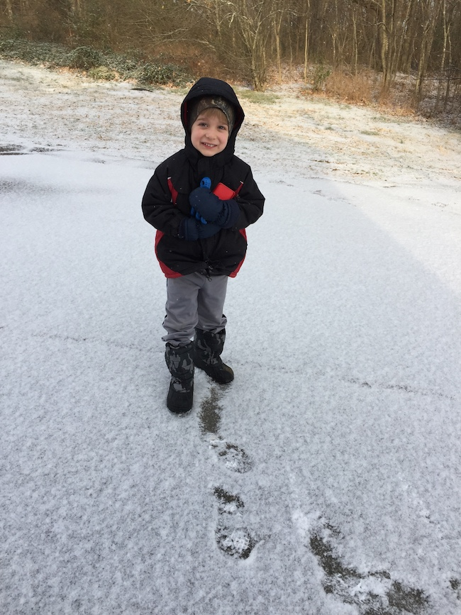 little boy in the snow