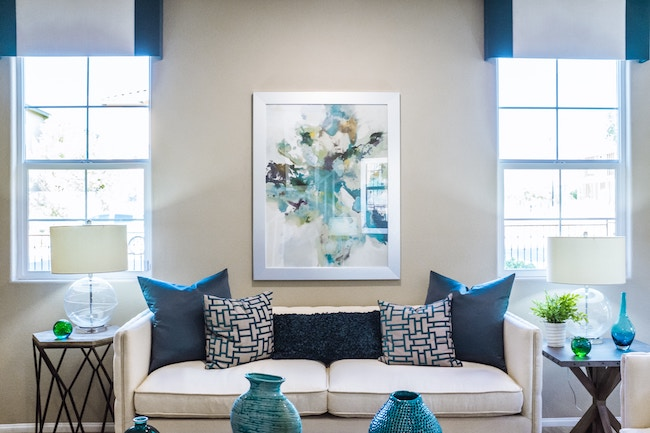 living room with white couch and blue accents