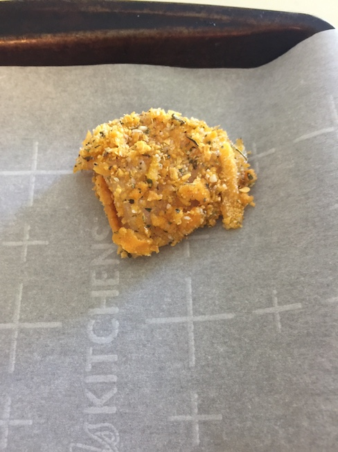 breaded chicken nugget on top of parchment paper
