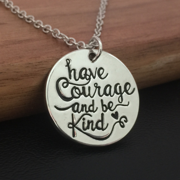 round silver pendant necklace with have courage and be kind