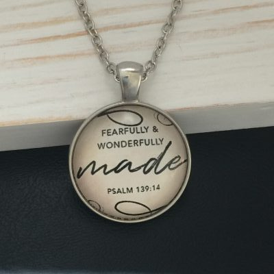 round pendant necklace with words fearfully and wonderfully made