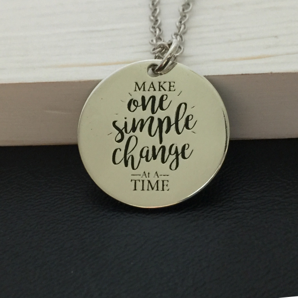 round silver pendant necklace with make one simple change at a time