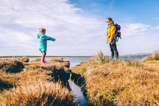 mom and daughter crossing lake