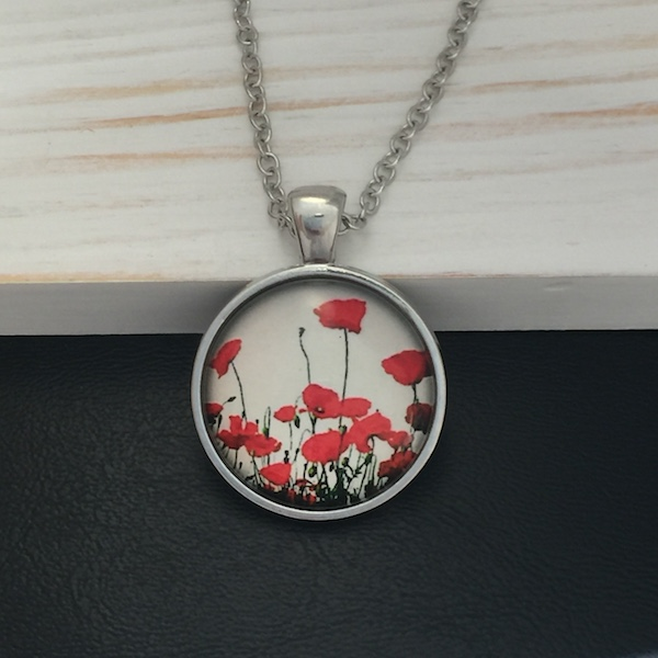 round pendant necklace with red poppies