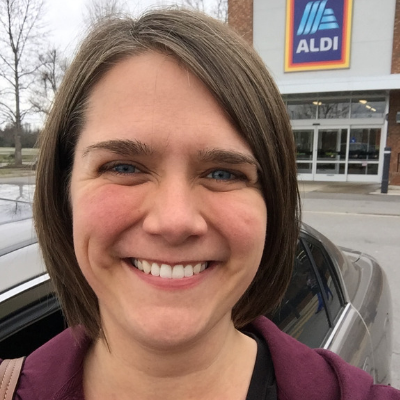 woman standing in front of Aldi
