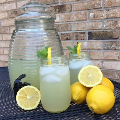 glasses of lavender lemonade in front of pitcher