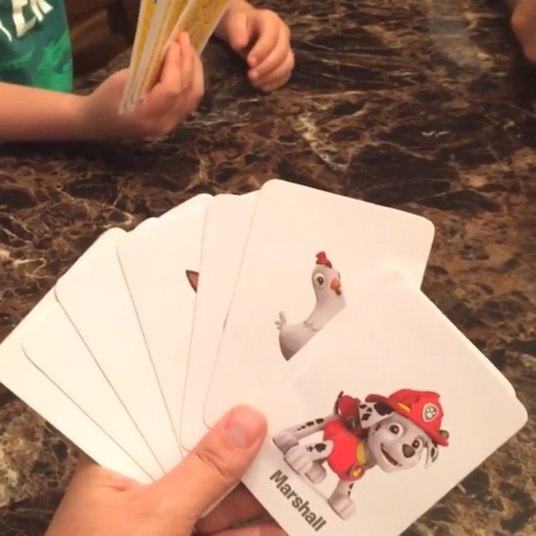 hand holding paw patrol playing cards