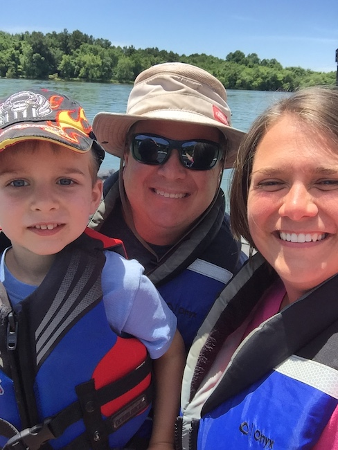 dad, mom and son in life vests