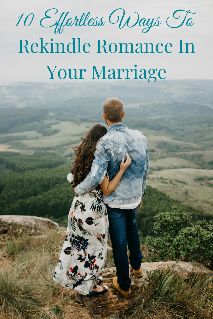 couple arm in arm on mountaintop