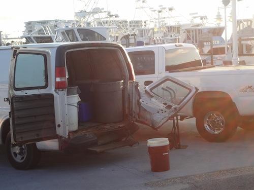 van with door falling off