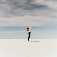 woman standing under a storm cloud