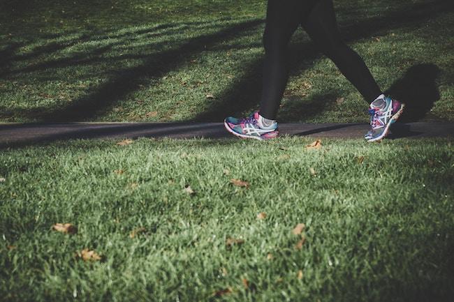 woman running through park