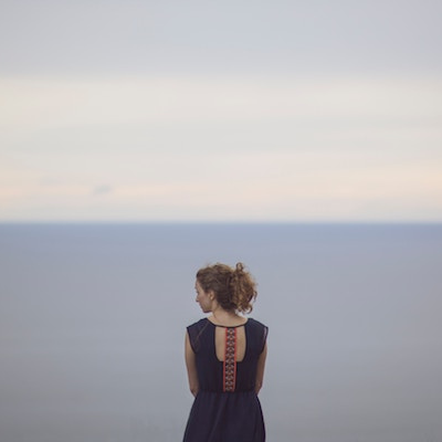 woman facing ocean
