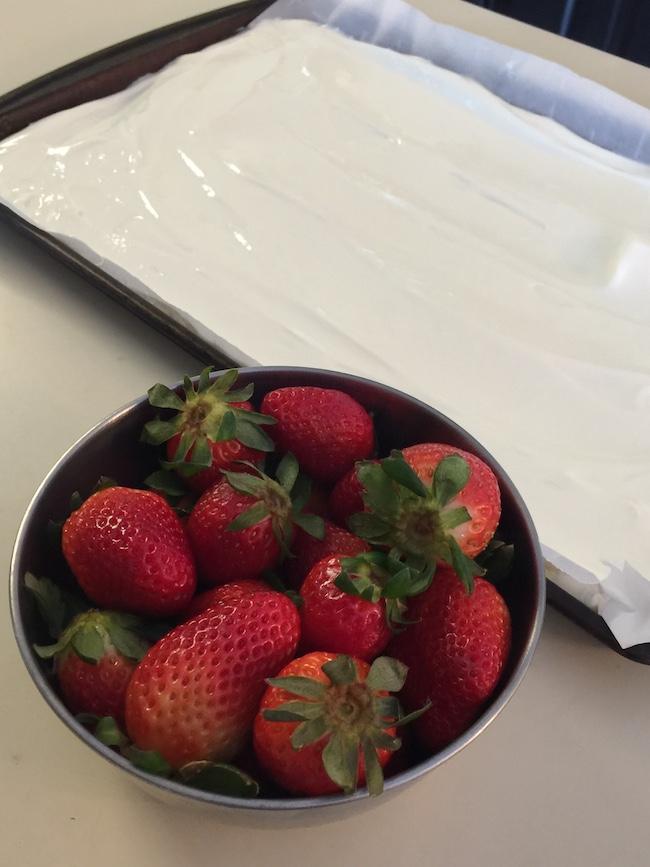 bowl of strawberries and pan with yogurt