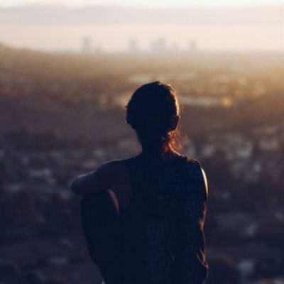 woman sitting overlooking a city