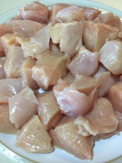 cubes of raw chicken