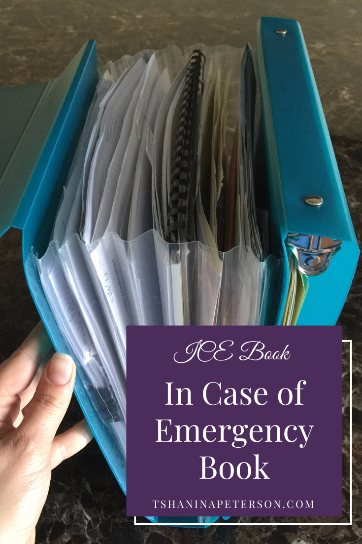 teal duo binder filled with paperwork for an emergency preparedness plan